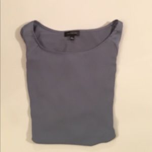 The limited periwinkle blouse over head size large